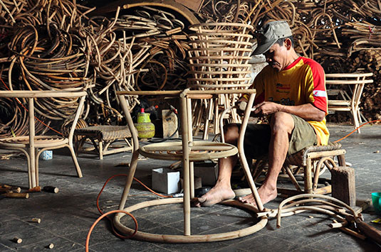 a-worker-is-making-a-rattan-furniture